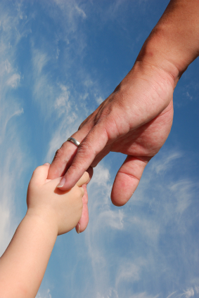 Kid holding father's hand