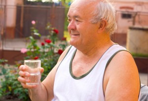 Old_Man_Drinking_water_iStock_000021460208Small